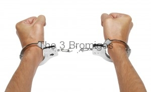 hands-and-breaking-handcuffs_shutterstock_58240561